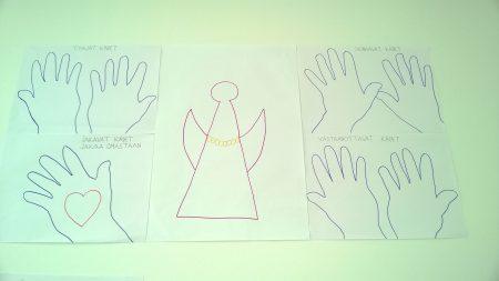 Supersankarin parantavat kädet. © Seija Koikkalainen